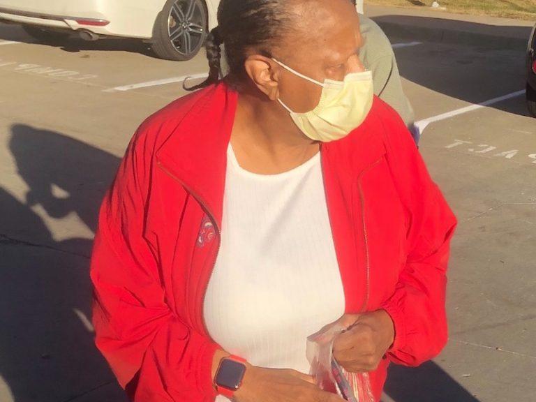 Woman in red jacket walking