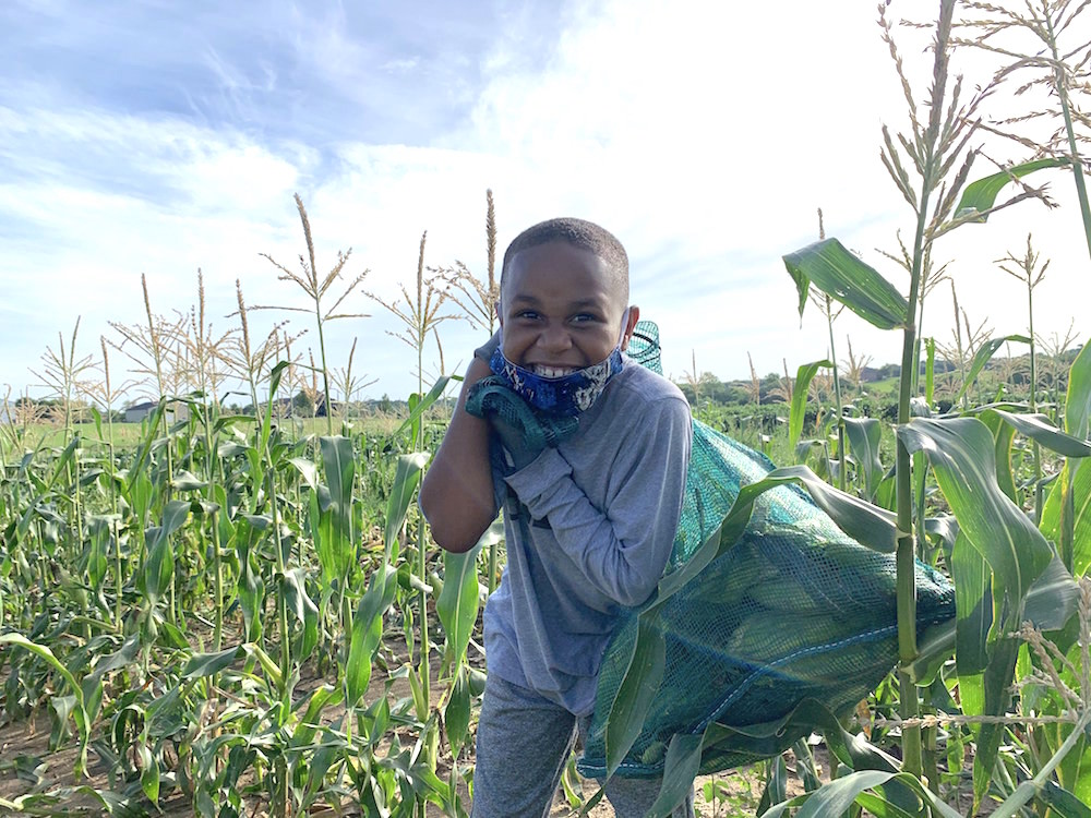 Smiling boy with corn