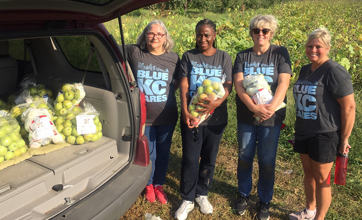 Ladies with bags of apples